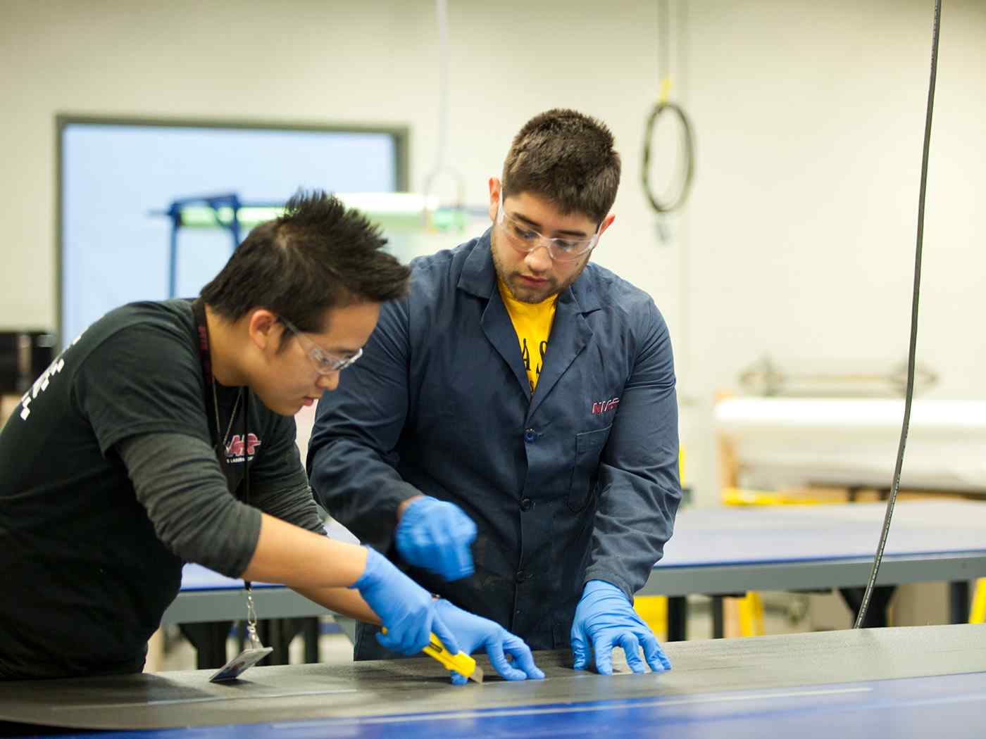 Graduate Engineering students working in NIAR lab.