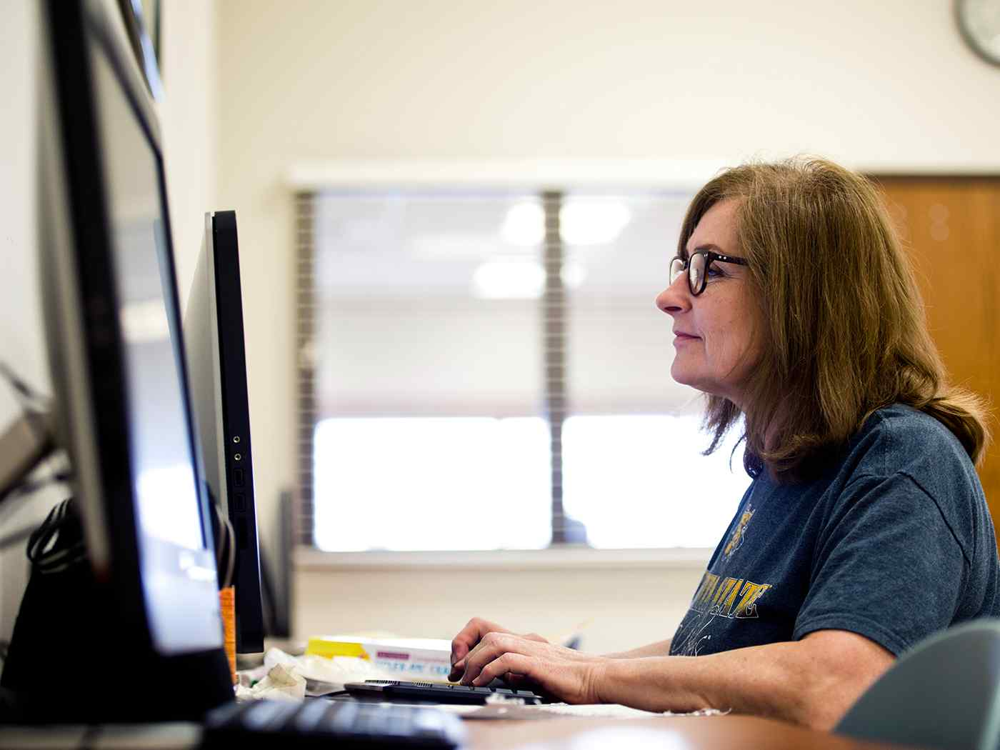Adult learner completing computer work