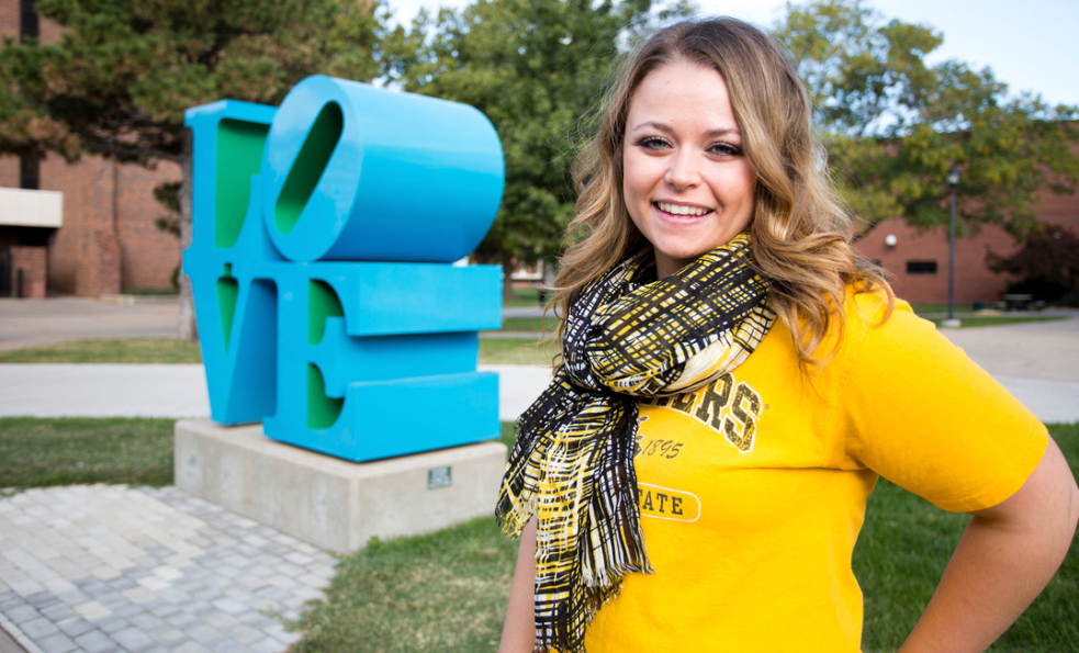 Female student standing near LOVE sculpture at WSU