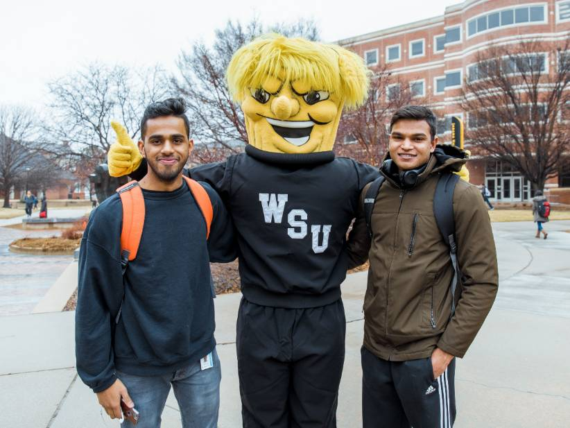 Wu posing with students