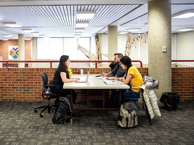 Adult learning students in library.