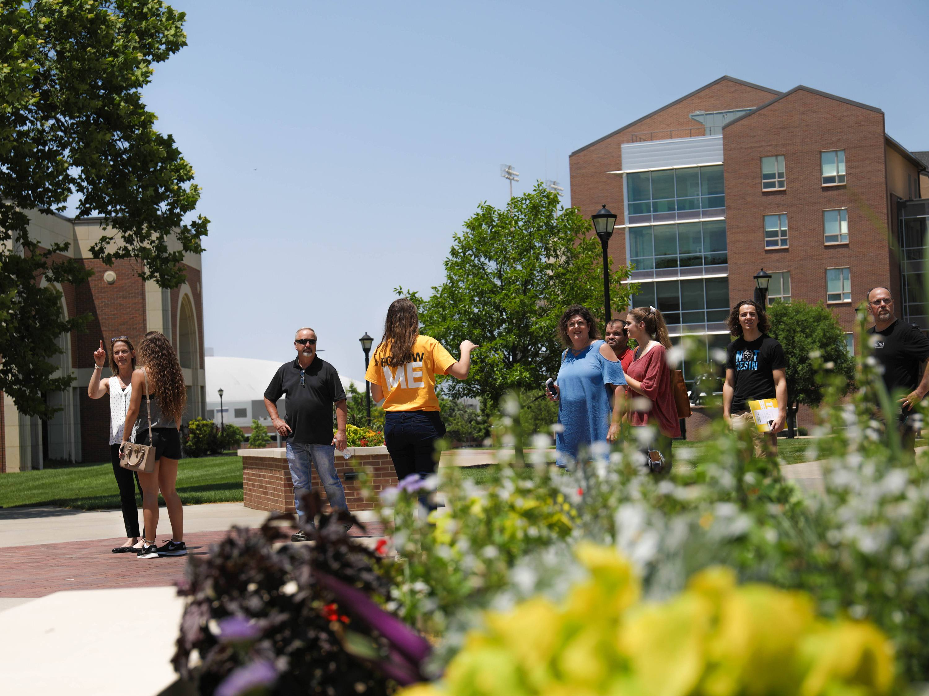 Students and their parents tour campus in the summer