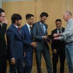 A team receiving an award.