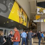 Judges talking to teams at the trade show in Koch Arena.