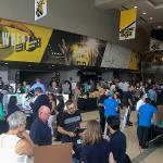 Individuals gathered at the trade show.