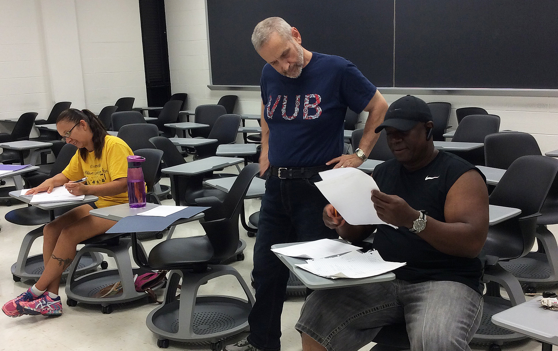 veteran student getting tutored in the classroom