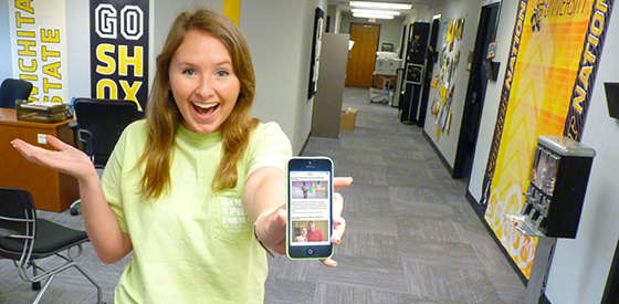 WSU student showing off webmail access via her mobile device.