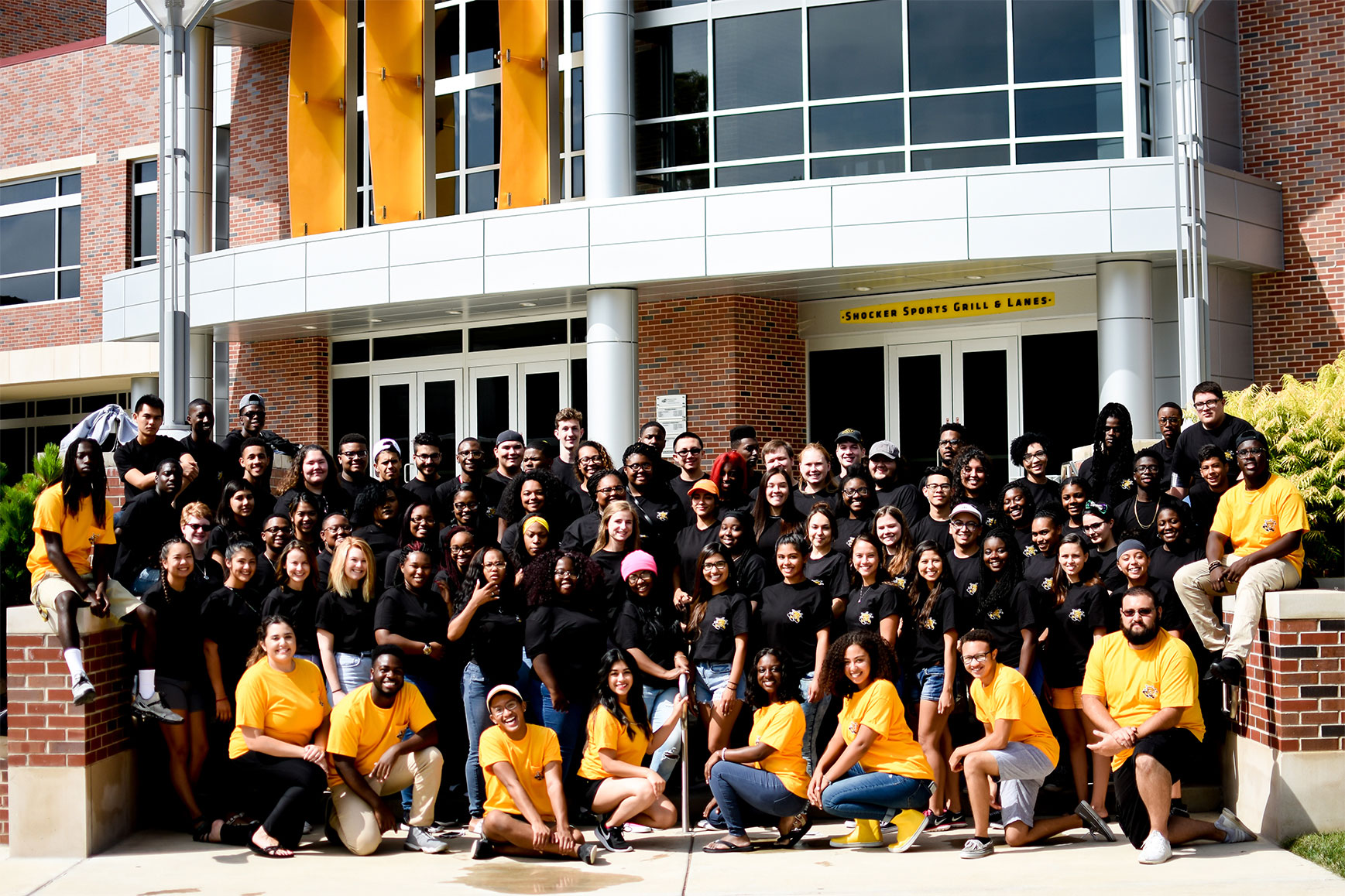 A group of students taking a picture together in front of RSC.