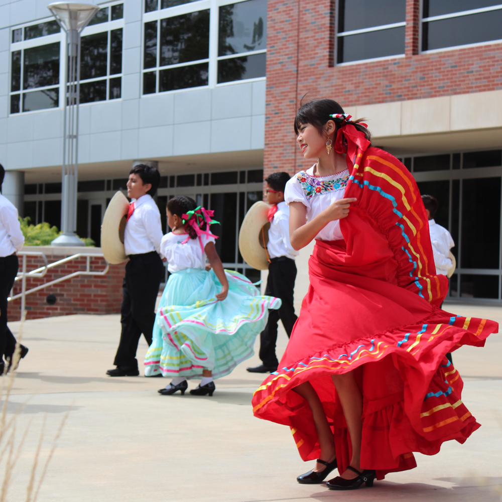Young children dancing to a traditional song at Latinx Heritage Month Celebration.