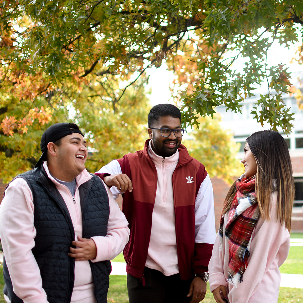 Students laughing with each other on campus.