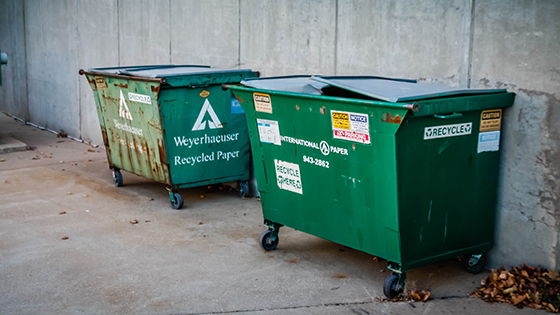 Recycling bins outside at the Devlin Hall dock