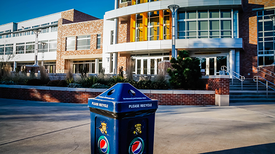 A recycling bin outside of the Rhatigan Student Center's north entrance