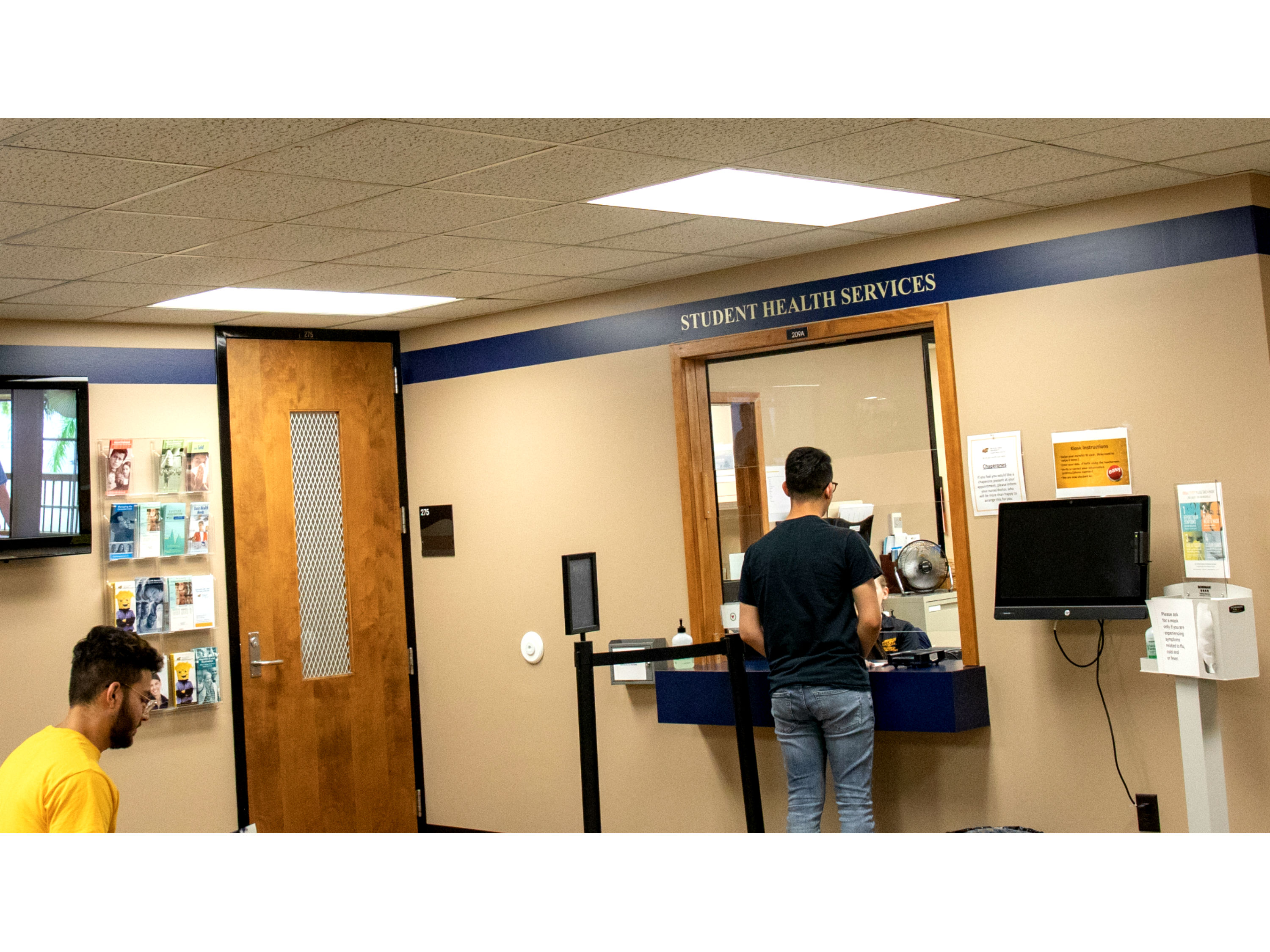 students checking in at student health services waiting room