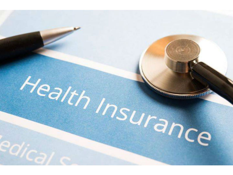 Health insurance with pen and stethascope