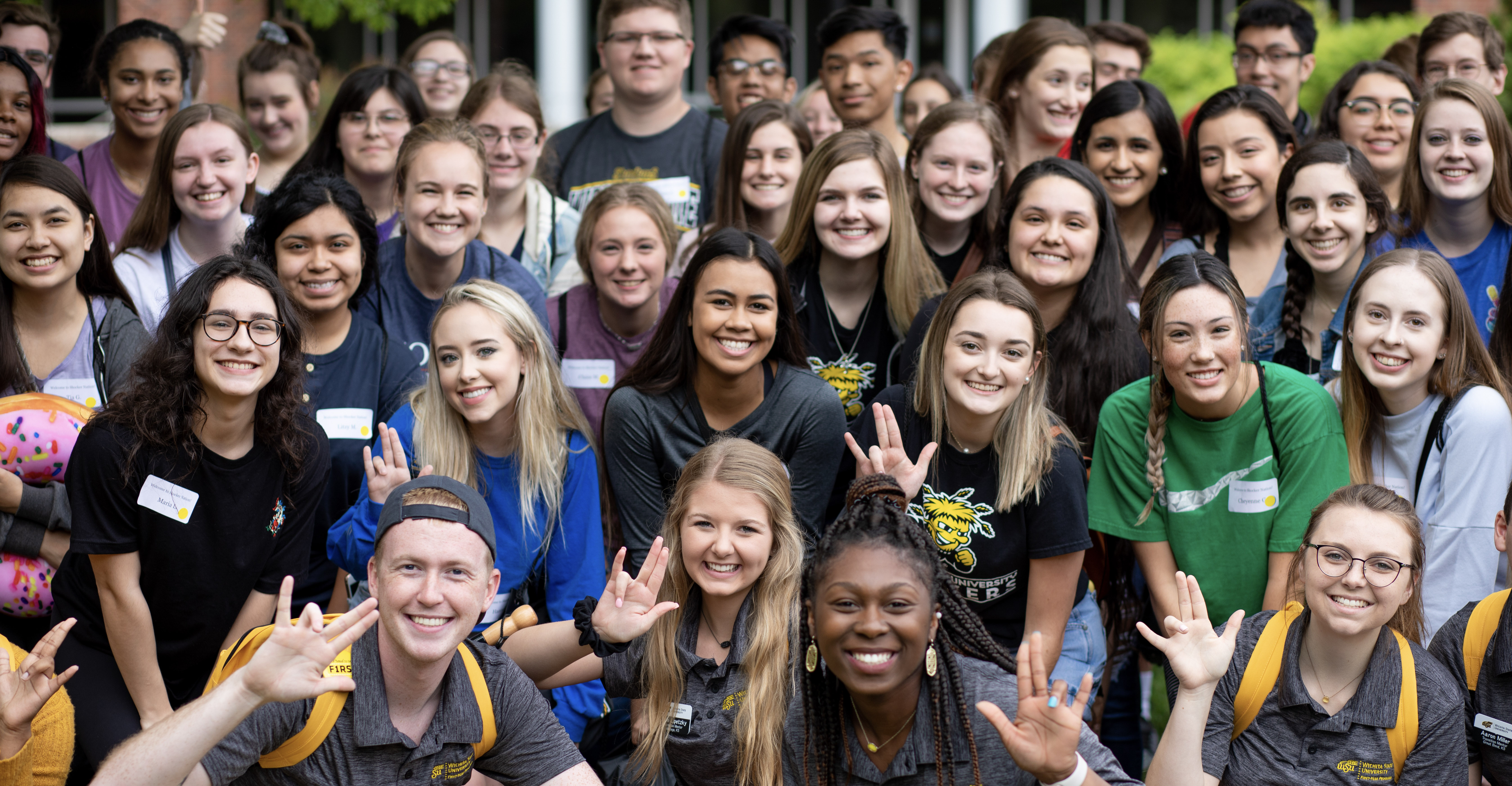 A diverse group of smiling students at freshman orientation