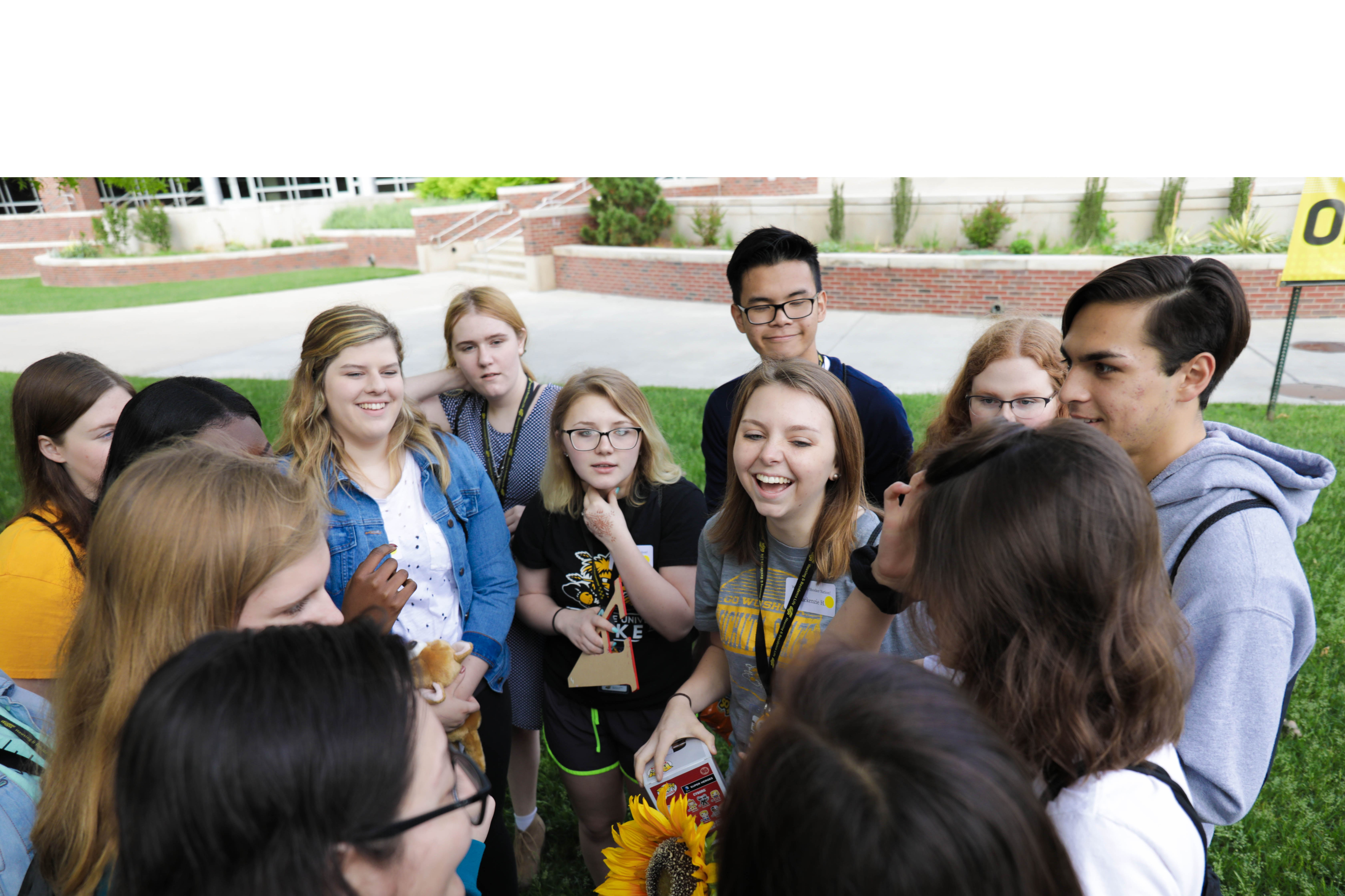 A transition mentor leads an ice-breaker activity with an orientation group
