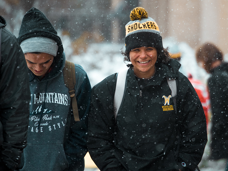 Students walk by the Rhatigan Student Center on a snowy winter day at Wichita State.