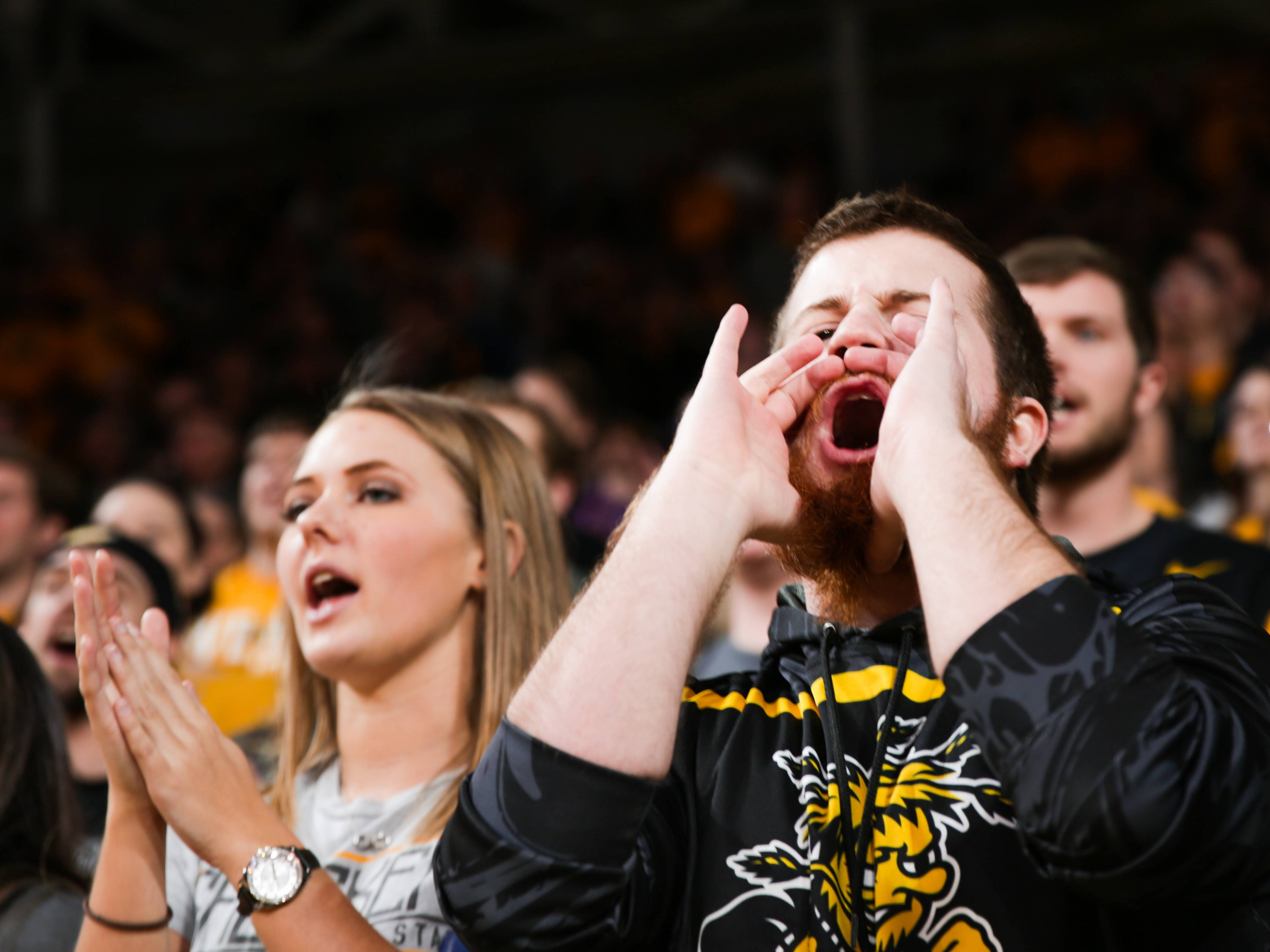 Shocker Basketball fans cheering.