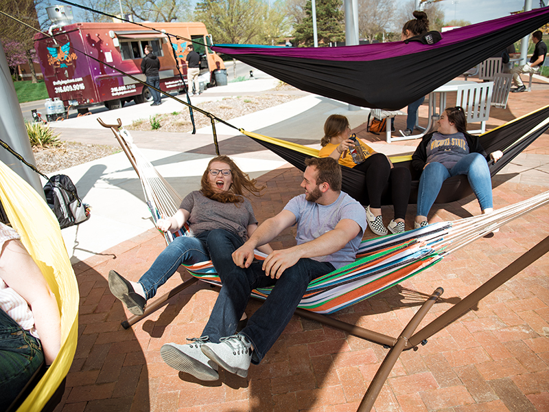Students in hammocks hanging at the Food Truck Plaza