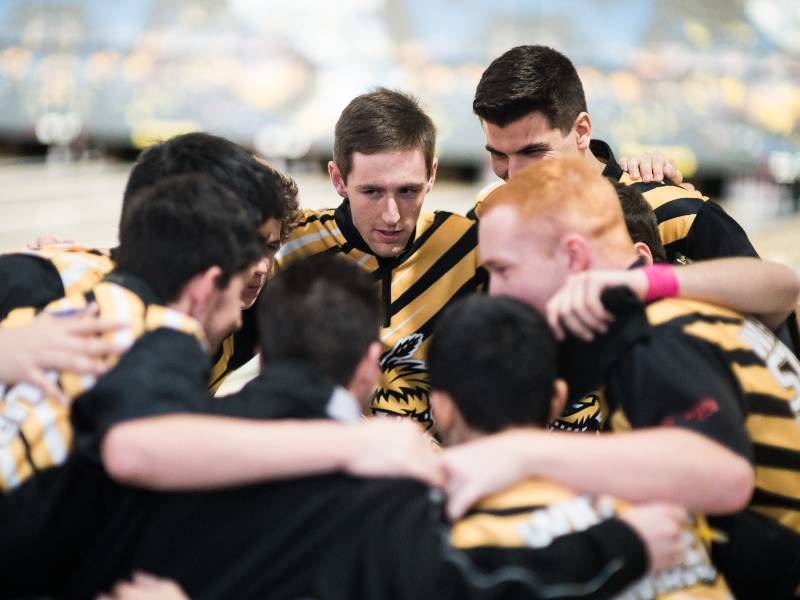 Shocker bowling team in huddle.