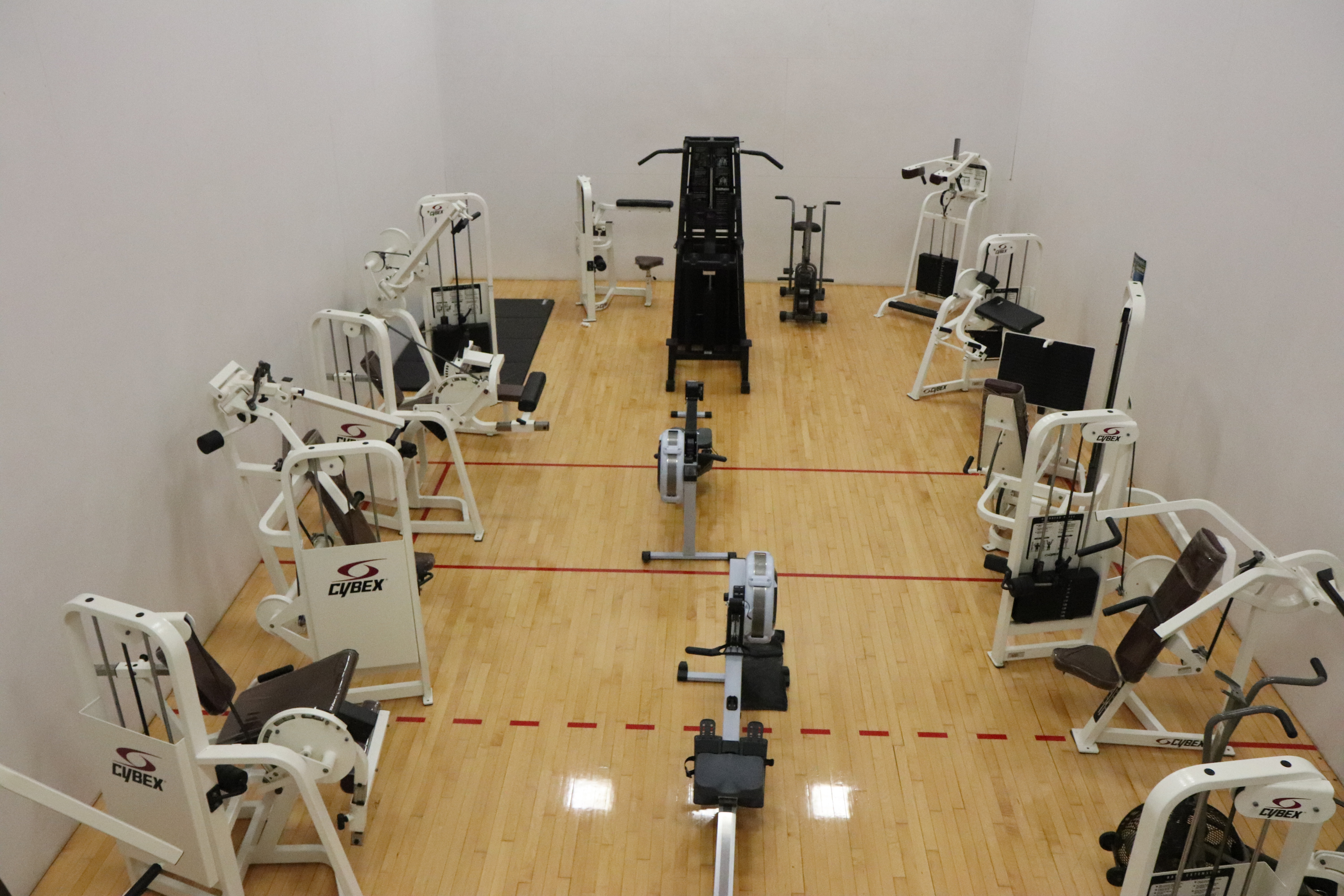 view of the circut room, a room with various exersize equipment on a gym type floor, from a high view.