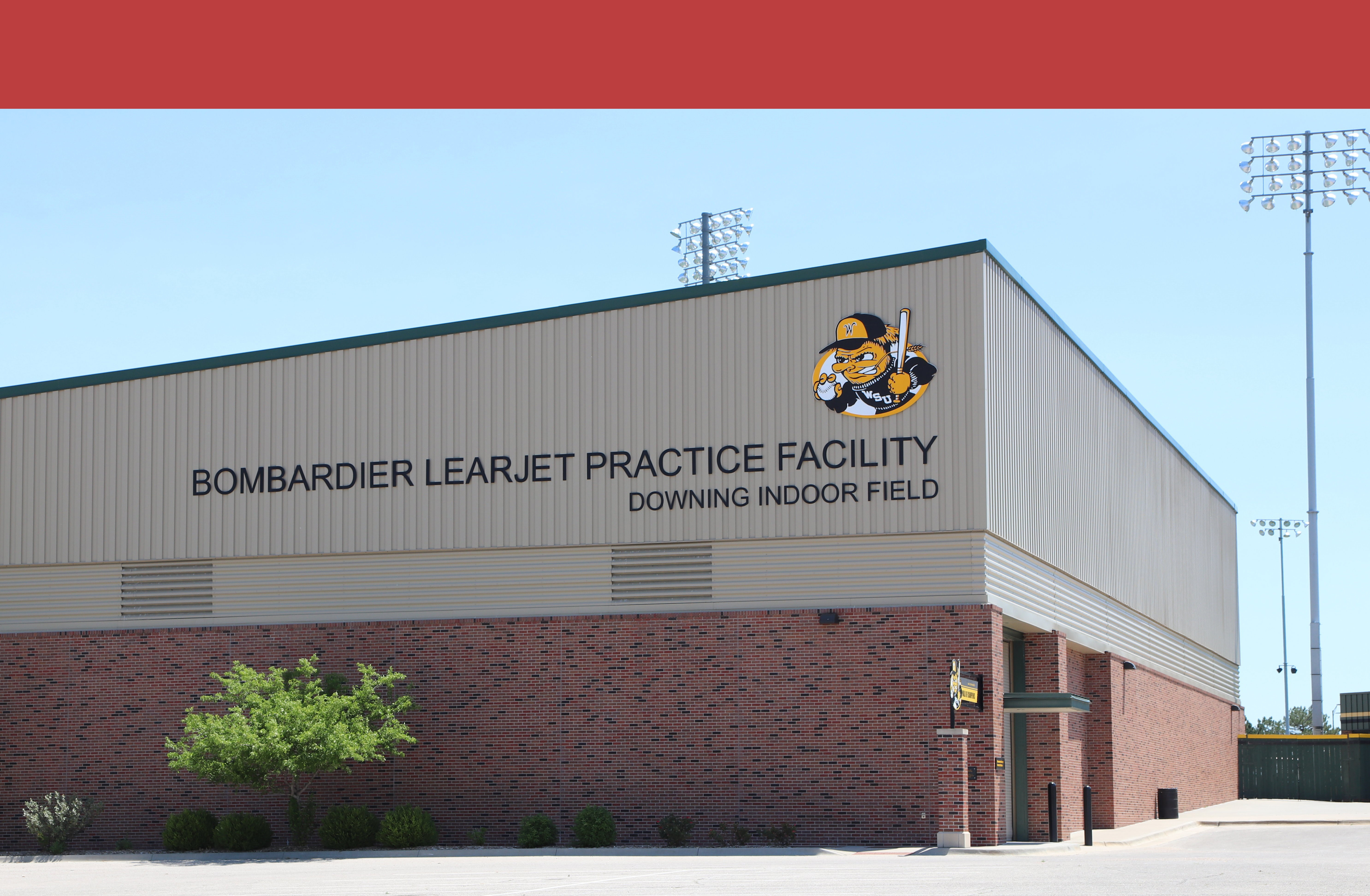 image of the side of the bombardier learjet practice facility. shows the baseball wu shock on the side.