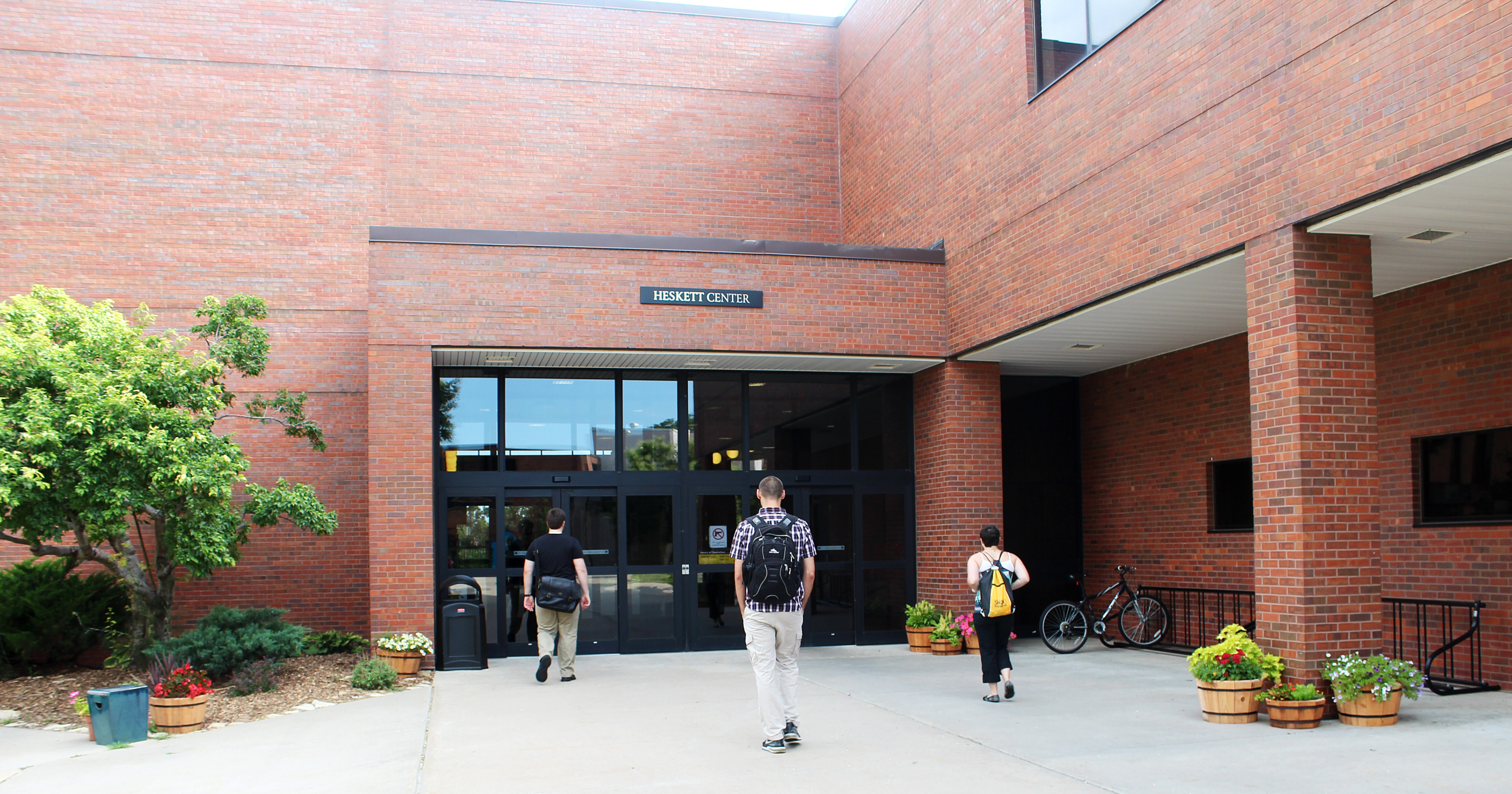 three students heading for the entrance of the Heskett Center